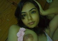 Sexy Pictures of Indian Teen Girl SHowing Big Boobs and Hairy Pussy Nude Photos